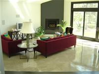 Light grey family room concrete floor
