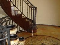 Tan concrete floor with staircase